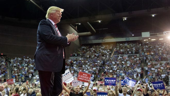 Donald Trump walks onto the stage during a rally at the Pensacola Bay Center on Friday, September 9, 2016.