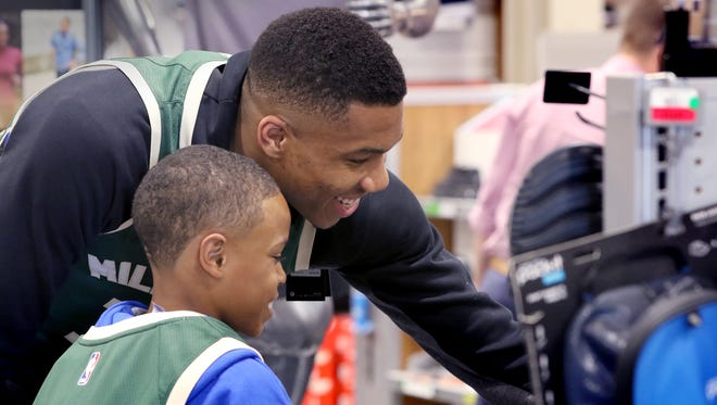 """Giannis Antetokounmpo shops with Jahcobie Dean, 12 as the Bucks star surprised 15 youth from the Milwaukee Boys & Girls Club """"Emerging Leaders"""" Basketball League on May 22 with autographed jerseys as a """"Thank You"""" to the city of Milwaukee for Antetokounmpo's Top 10 Ranking this season on DICK'S Sporting Goods Jersey Report. DICK'S also suprised each youth with a $100 shopping spree in the Wauwatosa store."""