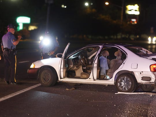 Delaware State Police officers investigate after a pedestrian was struck by a car on west bound Route 40 near Fox Run Shopping Center, reported about 11:10 pm Friday.