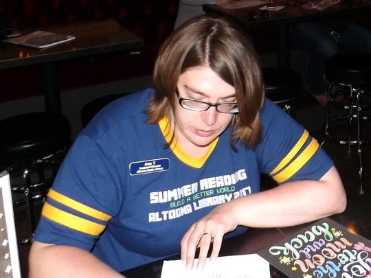 Amy Turgasen draws during adult coloring at Brewhouse