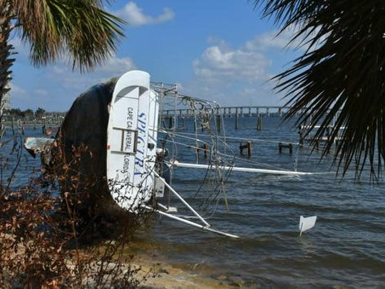 """The """"Spectra"""" on her side along the Indian River near the border fo Rockledge and Cocoa. Damage to boats, docks, trees, boat houses, and more along the Indian River in Cocoa and Rockledge on the Sunday after Hurricane Irma first hit the Space Coast."""