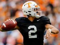 Tennessee quarterback Jarrett Guarantano (2) hands off the ball the NCAA college football team's Orange and White spring game Saturday, April 13, 2019, in Knoxville, Tenn. (Joy Kimbrough/The Daily Times via AP)