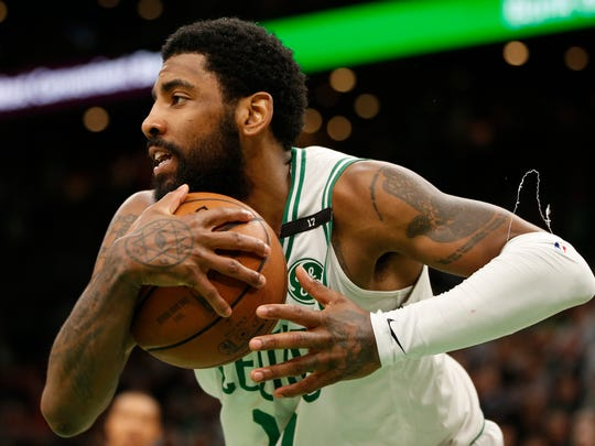 May 6, 2019; Boston, MA, USA; Boston Celtics guard Kyrie Irving (11) pulls down a rebound during the second half in game four of the second round of the 2019 NBA Playoffs against the Milwaukee Bucks at TD Garden. Mandatory Credit: Greg M. Cooper-USA TODAY Sports