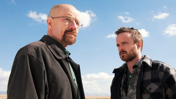 Bryan Cranston as Walter White and Aaron Paul as...