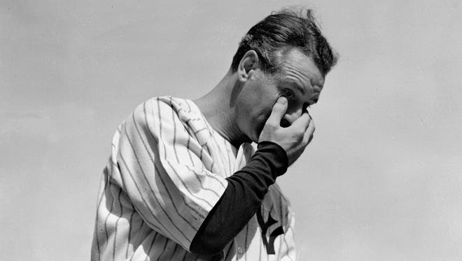 Lou Gehrig wipes away a tear while speaking during a tribute at Yankee Stadium in New York on July 4, 1939.