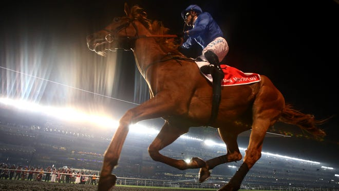 African Story, ridden by Silvestre De Sousa, wins the Dubai World Cup at the Meydan Racecourse on Saturday.