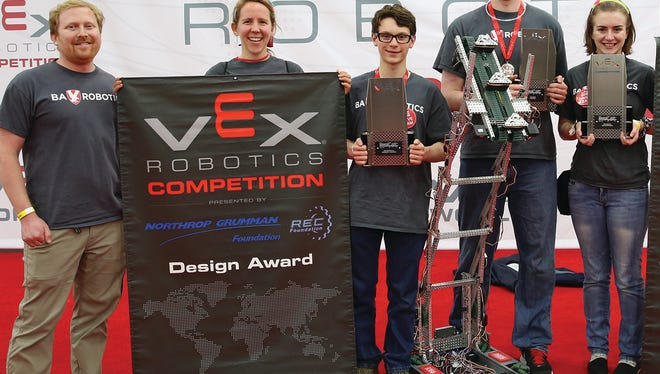 Members of Brentwood Academy's robotics Team and sponsors celebrate at the World Championship in Robotics Engineering.  From left: Faculty members Chris Allen and Wendy Stallings with students Noah Franks, Peter Richards and Olivia Cook.