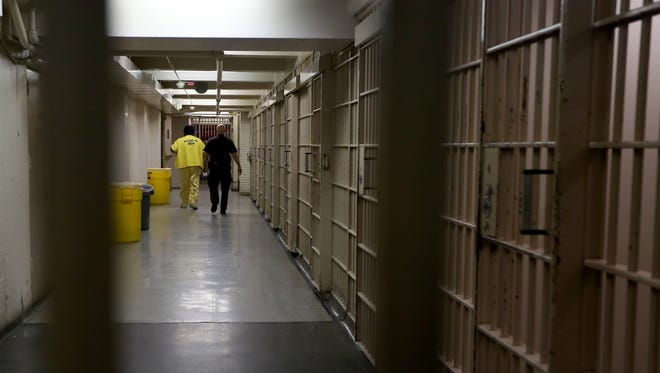 A deputy walks with an inmate at the Wayne County Jail in Detroit on July 31, 2015. (Photo: Jessica J. Trevino, Detroit Free Press)