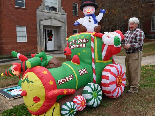 Rev. Mike Vandiver of Anderson set up an inflatable