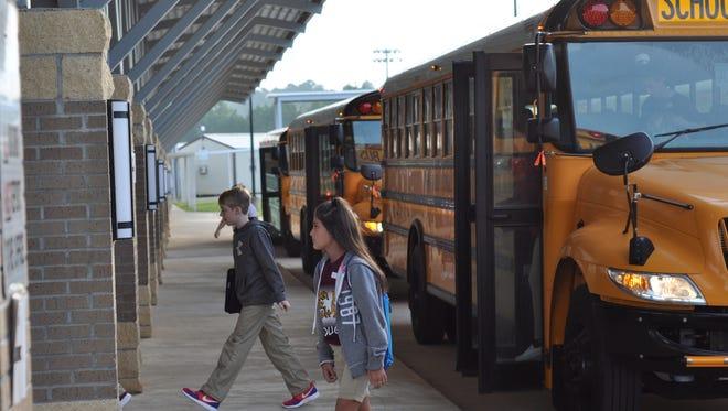 Students return to school Wednesday morning at Grant Junior High School.