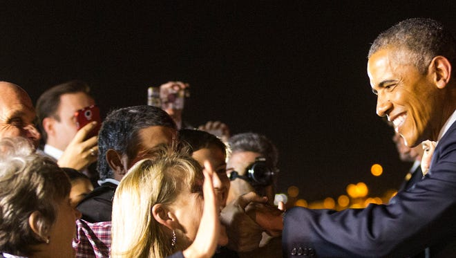 President Barack Obama greets supporters after arriving at Phoenix Sky Harbor Airport on Wednesday, Jan. 7, 2015.