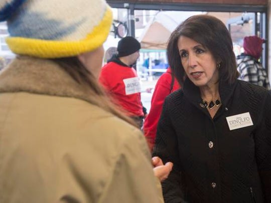 Republican Monroe County executive candidate Cheryl Dinolfo speaks with a resident at the Public Market.