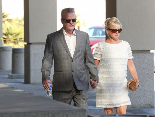 Richard and Heidi Meaney enter the Larson Justice Center