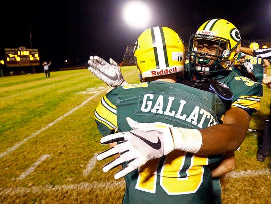 Gallatin's Hunter Anderson is congratulated by teammate