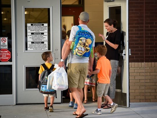 Special education teacher Ashley Martin welcomes students