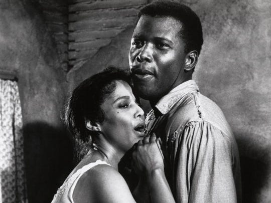 Publicity still of Dorothy Dandridge and Sidney Poitier in 'Porgy and Bess' (Columbia Pictures), 1959. (Photo by John D. Kisch/Separate Cinema Archive/Getty Images)
