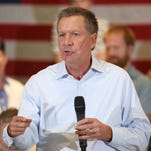 John Kasich, Ohio governor and the 16th major candidate seeking the GOPÕs 2016 nomination, speaks to a crowd during the Nashua Town Hall Meeting on Tuesday evening while officially campaigning in New Hampshire.