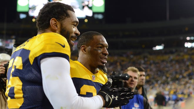 Green Bay Packers outside linebacker Julius Peppers  and safety Ha Ha Clinton-Dix  make their way to the tunnel following their victory pver the San Diego Chargers at Lambeau Field on Sunday, Oct. 18, 2015.