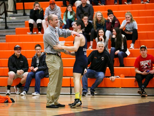 Sprague wrestling coach Nolan Harris shakes hands with Ukraine's Andrii Dzhelep after Dzhelep finished wrestling Sprague's Daniel McClung at Sprague High School on Tuesday, March 8, 2017. Members of the Ukrainian Junior National Team are touring Oregon, and stopped in Salem to compete against area high school all-stars. Dzhelep is a 2016 cadet world champion in the 17 and under division.