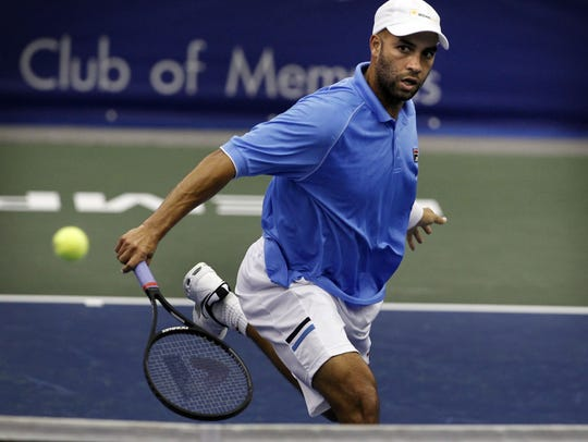 February 21, 2012 - James Blake returns a volley by