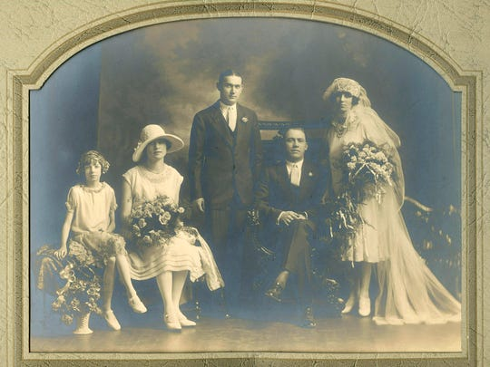 Lillian Ruth Willman Ernst's wedding photo. She's on the right; seated is her husband, Edward George Ernst.