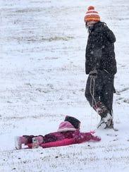 Kristina Arlund pulls her 4-year-old daughter Niko,