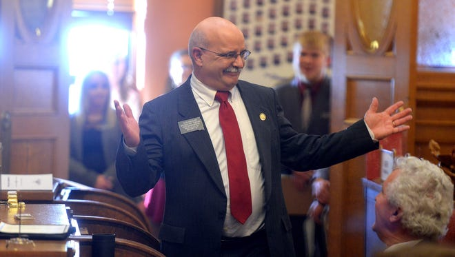 Rep. Don Haggar responds to some friendly ribbing after being chosen as House Pro Temp before the State of the State address Tuesday in Pierre.