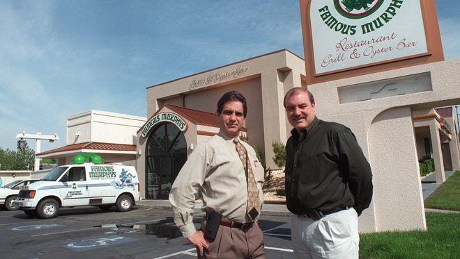 Tim Wiltshire, left, and Mike Wiltshire stand in front of their Famous Murphy's Restaurant Grill and Oyster Bar on June 5, 1998 in south Reno.