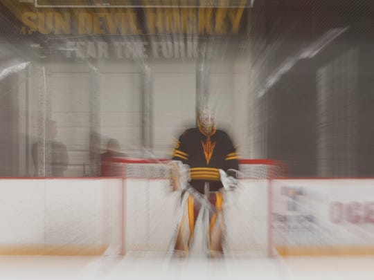 ASU's goalie Joey Daccord waits for period to begin against UMass-Lowell at Oceanside Ice Arena on January 12, 2018 in Tempe, Ariz.