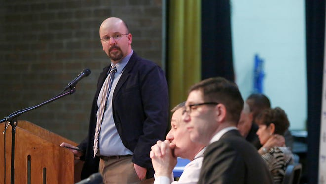 Journal News staff writer David Robinson, left, moderated a painkiller and heroin addiction and overdoses during a forum hosted by the Journal News/Lohud.com at Walter Panas High School on Tuesday, Feb. 2, 2016.