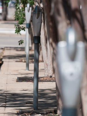 Parking meters line a street in downtown Pensacola in this file photo.