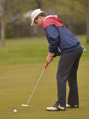 Sending a putt on its way Tuesday is Salem's Hayden