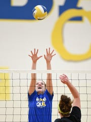 Kimball's Madison Hurrle goes up to block a spike during