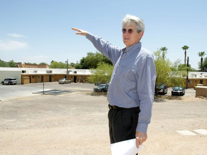 SouthBridge developer Fred Unger stands on a dirt patch