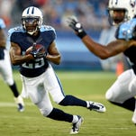 Titans cornerback Perrish Cox (29) races up the field with an interception for a touchdown against the Rams during a preseason game.