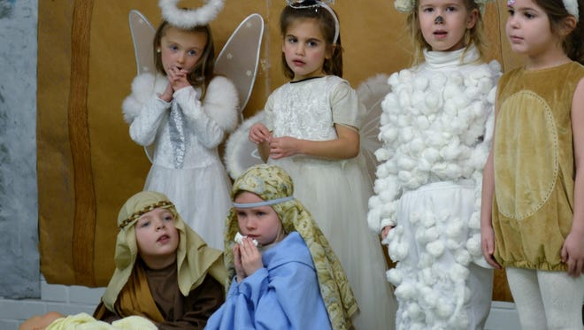 Pictured are the angels Kate Bertoli and Mia Remke, both of Villa Hills, sheep Maura Dwyer, of Taylor Mill, and rabbit Sophia Mangine, of Villa Hills. Seated are Mary and Joseph, played by Luca Presti, of Fort Mitchell, and Meredith Comte, of Burlington.