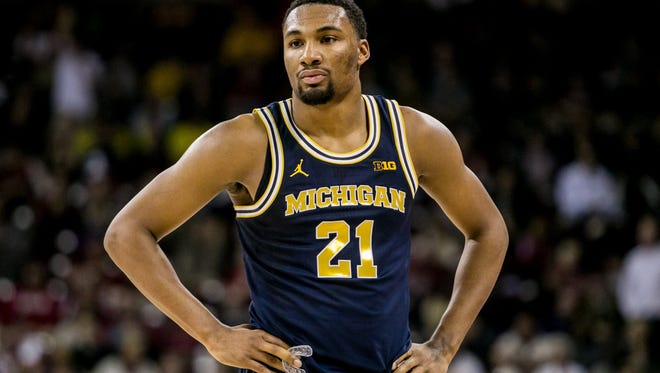 Michigan Wolverines guard Zak Irvin (21) reacts after fouling out against the South Carolina Gamecocks in the second half at Colonial Life Arena. The South Carolina Gamecocks won 61-46.