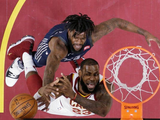 Cleveland Cavaliers' LeBron James, right, loses control of the ball under pressure from Detroit Pistons' Reggie Bullock in the first half of an NBA basketball game, Monday, March 5, 2018, in Cleveland. (AP Photo/Tony Dejak)