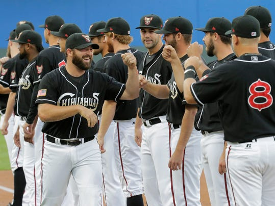 Cody Decker greets his teammates as fans wave their rally towels at Southwest University Park on Opening Day 2015. The Chihuahuas took on the Tacoma Rainers to kick-off the season.