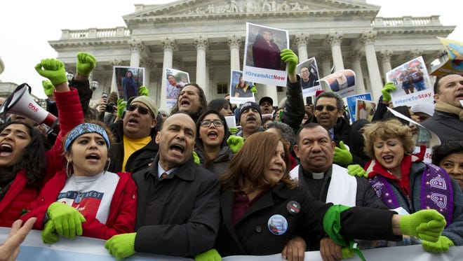 In this Dec. 6, 2017 photo, Rep. Luis Gutierrez, D-Ill., third from left, along with other demonstrators protest outside of the U.S. Capitol in support of the Deferred Action for Childhood Arrivals (DACA), and Temporary Protected Status (TPS), programs, during a rally on Capitol Hill in Washington.