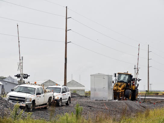 A crew works along the BNSF Railway crossing at Sherburne