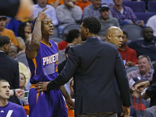 Teammates restrain Phoenix Suns guard Archie Goodwin