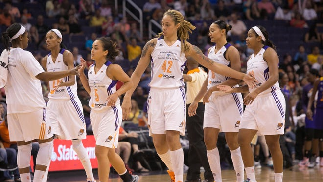 The Phoenix Mercury celebrate during a time out during the game against the Phoenix Mercury vs. Los Angeles Sparks at US Airways Center, Friday, September 11, 2015, in Phoenix, Ariz.