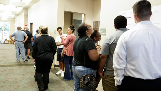 A line of voters at the South Regional Library on Election Day in Lafayette Nov. 8, 2016.