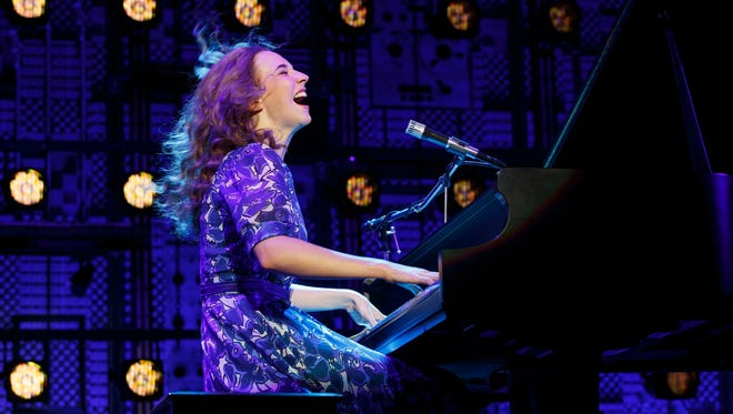 """Julia Knitel stars as singer/songwriter Carole King in """"Beautiful – The Carole King Musical,"""" playing through May 14 at the Aronoff Center as the final show of the 2016-2017 Broadway in Cincinnati series. This scene reenacts her 1971 Carnegie Hall concert. In 1996, the audio from the performance became a best-selling album."""