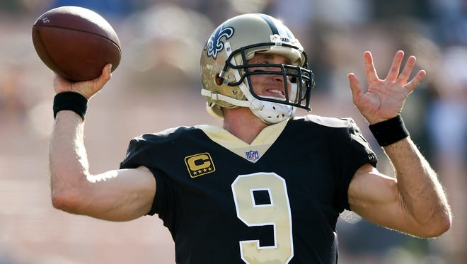 New Orleans Saints quarterback Drew Brees warms up before an NFL football game against the Los Angeles Rams, Sunday, Nov. 26, 2017, in Los Angeles. (AP Photo/Kelvin Kuo)