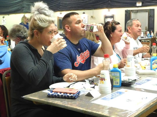 From left, Hannah Wagner, Allen Dorsey and Lela Gregory, all of Fremont, grab an early pancake breakfast Wednesday morning.