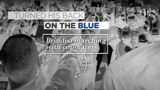 "A still from an advertisement from former Congresswoman Claudia Tenney's campaign that accused Brindisi of marching with ""cop-haters"" during a June rally in Utica following the death of George Floyd at the hands of Minneapolis police."