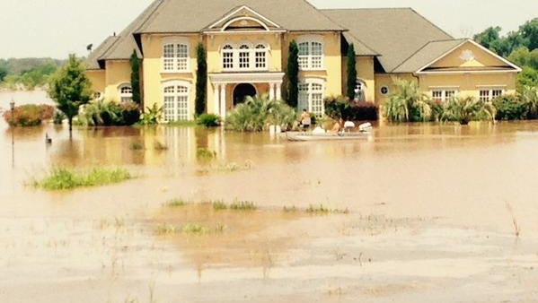 A River Bluff resident uses boat to get to a house.