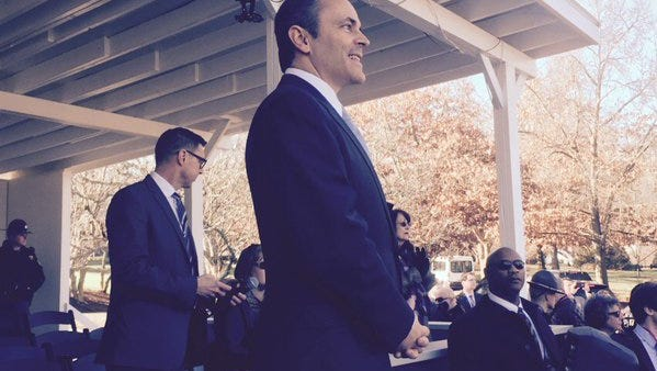 Bevin watches his inaugural procession in Frankfort